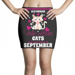 never underestimate an old woman who loves cats and was born in septem Mini Skirts | Artistshot