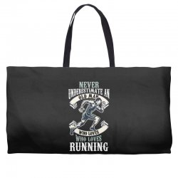 never underestimate an old man who loves running Weekender Totes | Artistshot