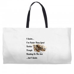 i swim... i am faster than land turtles trough floating in the sea   . Weekender Totes | Artistshot
