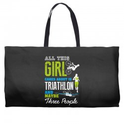 all this girl cares about is triathlon and maybe three people.  run sw Weekender Totes | Artistshot