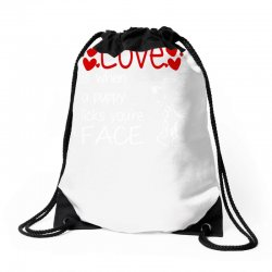 love is when a puppy Drawstring Bags | Artistshot
