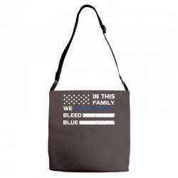 in this family we bleed blue funny Adjustable Strap Totes | Artistshot